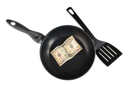 Banknotes in a frying pan with cooking spatula isolated on white Stock Photo - 14536480