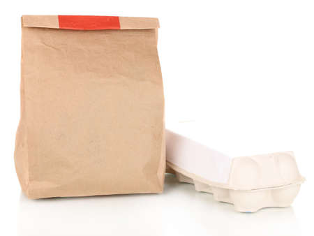 Closed paper bag with food isolated on white photo