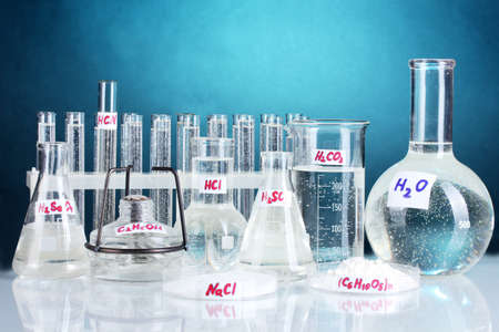 reagents: Test-tubes with various acids and chemicals  on bright background