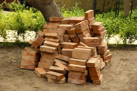 sameness: Heap of red bricks in yard