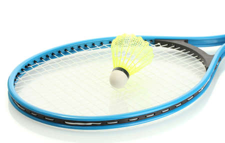 Badminton racket and shuttlecock isolated on white photo