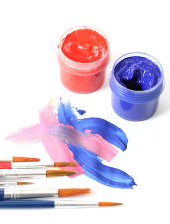 Abstract gouache paint, cans  and brushes, isolated on white photo