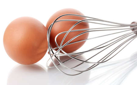 single whip: Metal whisk for whipping eggs and brown eggs isolated on white Stock Photo