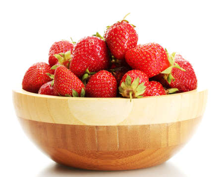 sweet ripe strawberries in wooden bowl isolated on white Stock Photo - 14706010
