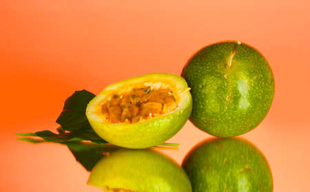 green passion fruit on pink background close-up photo