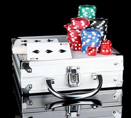 Poker set on a metallic case isolated on black background Stock Photo - 14707174