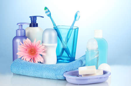 personal hygiene: bathroom setting on blue background Stock Photo