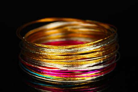Beautiful bracelet isolated on black background photo