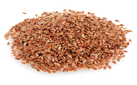 heap of flax seeds isolated on white background photo