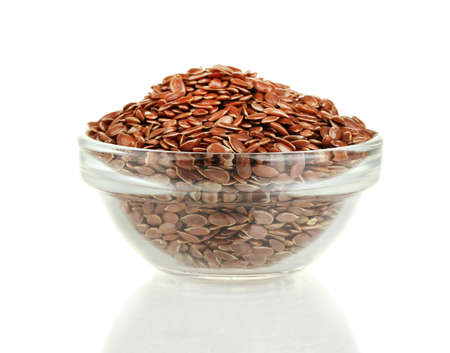 flax seeds in glass bowl isolated on white photo