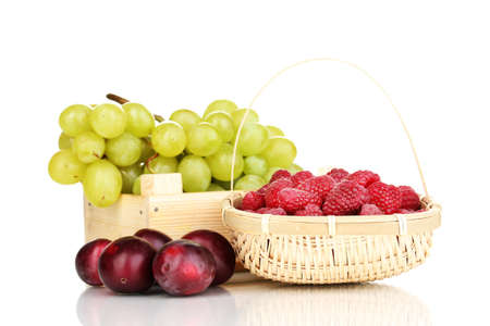 ripe fruits and berries isolated on white photo