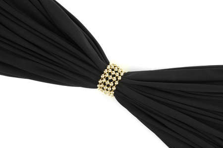 Black cloth tied with pearls isolated on white photo