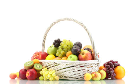 Assortment of exotic fruits in basket isolated on white Stock Photo - 14706936