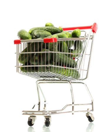 Fresh cucumbers in trolley isolated on white photo