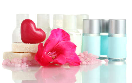 cosmetic bottles, soap and flower, isolated on white  photo