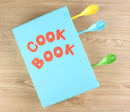 Cookbook and kitchenware on wooden background Stock Photo - 14707478