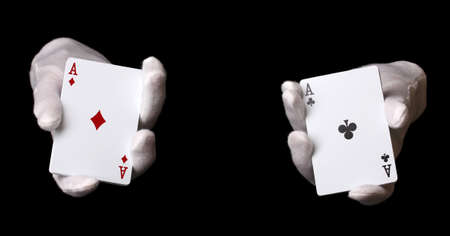 croupier: Cards in hands isolated on black
