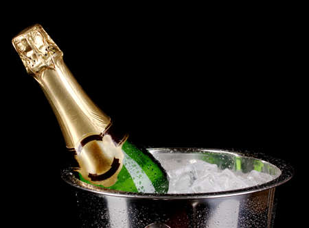 Bottle of champagne in bucket isolated on black Stock Photo - 14706769