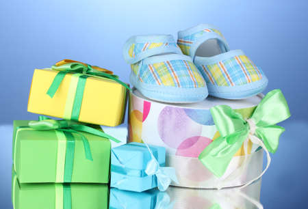bootees: beautiful gifts and babys bootees on blue background