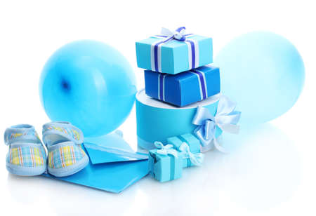 beautiful gifts, babys bootees and balloons isolated on white photo