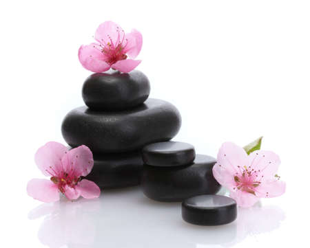 Spa stones and pink sakura flowers isolated on white  Stock Photo - 14706723
