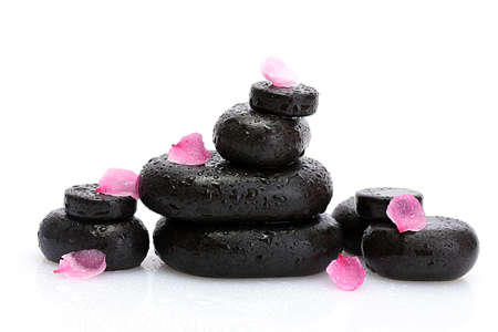 Spa stones with drops and pink petals isolated on white Stock Photo - 14707509