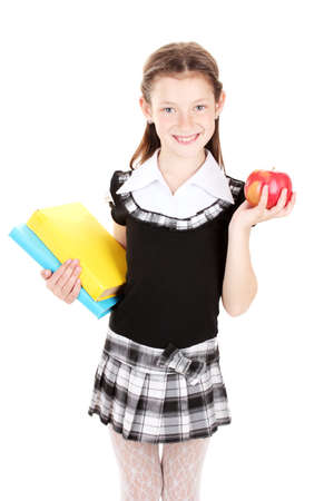 beautiful little girl in school uniform with books and apple isolated on white photo