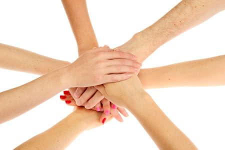commitment: grupo de las manos de los j�venes aislados en blanco Foto de archivo