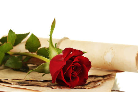 The old parchments and letters with a rose on a white background close-up photo
