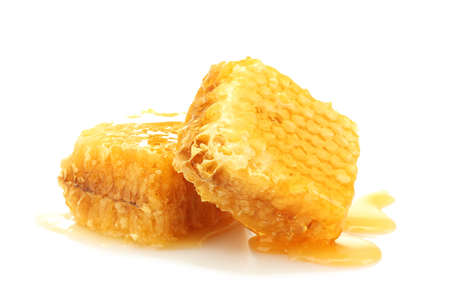 golden honeycombs with honey isolated on white  photo