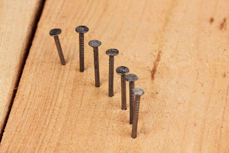 split rail: Metal nails in wooden plank