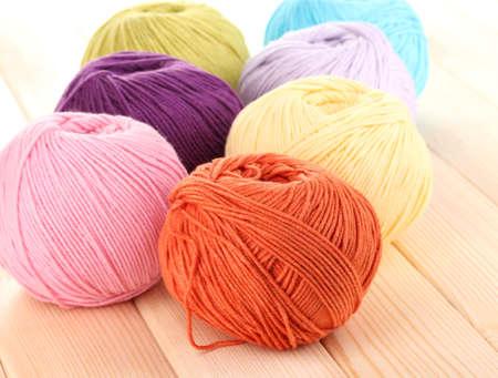 Knitting yarn on wooden background photo