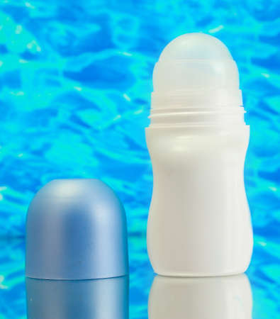 deodorant on blue sea background photo