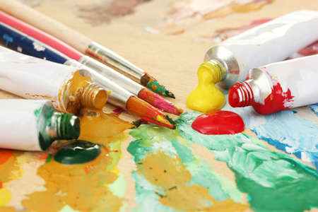 Abstract acrylic paint, paint tubes and brushes on wooden  palette Stock Photo - 14709408