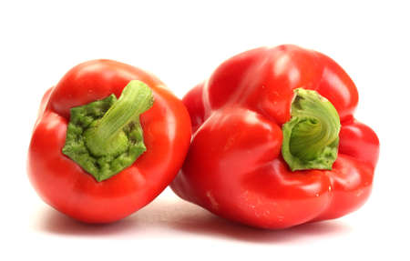 paprica: fresh red bell peppers isolated on white Stock Photo