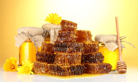 sweet honeycombs, barrel and jars with honey, isolated on white photo