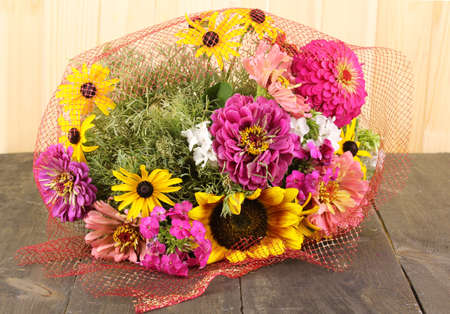 ronantic: Beautiful bouquet of bright flowers on wooden background