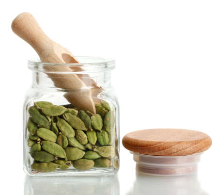 Jar of cardamom isolated on white close-up Stock Photo