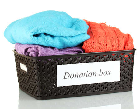 Donation box with clothing isolated on white Stock Photo - 14712692
