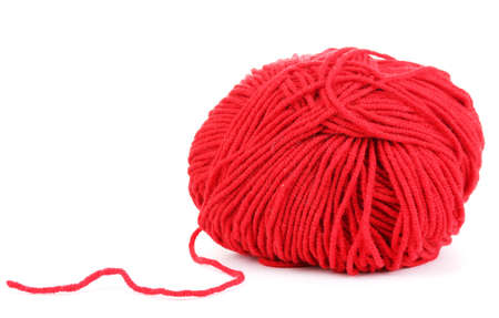 Red knitting yarn isolated on white photo