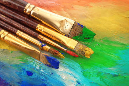 acrylic paint and brushes on wooden palette Stock Photo - 14712984
