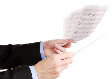 Music conductor hands with baton and notes isolated on white photo