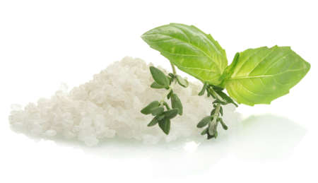 salt with fresh thyme and  basil isolated on white photo