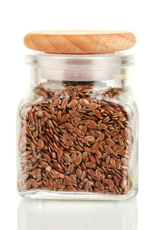 flax seeds in glass jar isolated on white photo