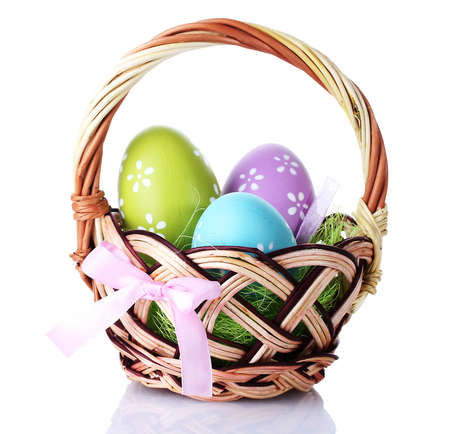 gift basket: basket with Easter eggs isolated on white Stock Photo
