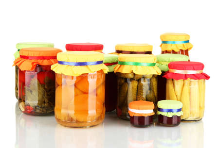 Jars with canned fruits and vegetables isolated on white photo