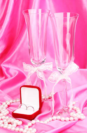 Wedding accessories on pink cloth background photo