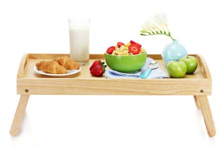 light breakfast on wooden tray isolated on white photo