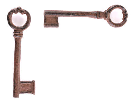 Two antique keys isolated on white photo
