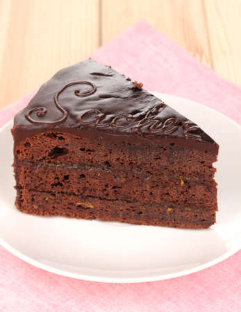 torte: Chocolate sacher cake on wooden table Stock Photo